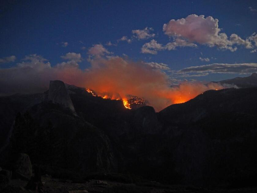 A wildfire in Yosemite National Park grew to more than 2,000 acres overnight Sept 7.