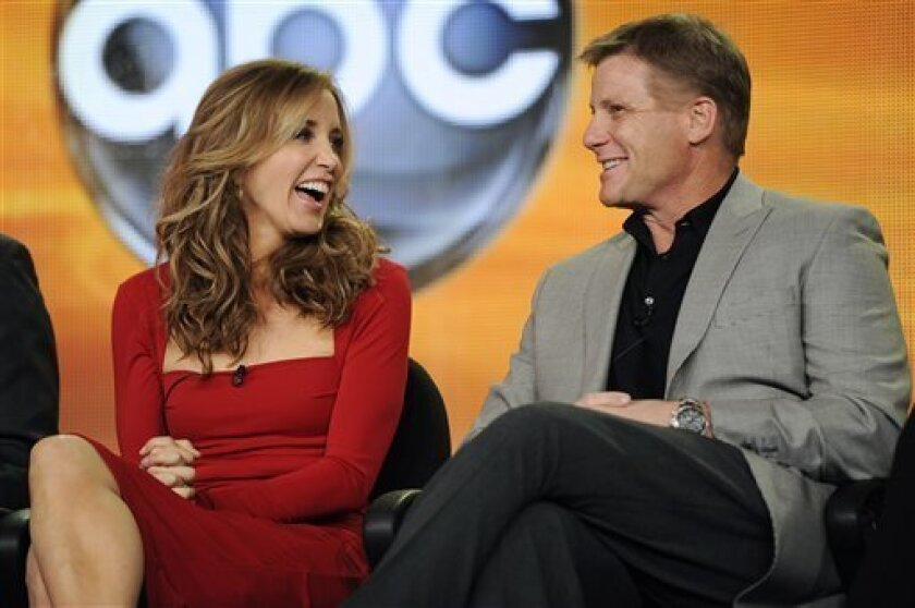 "Felicity Huffman, left, and Doug Savant, cast members in the ABC series ""Desperate Housewives,"" share a laugh onstage during a panel discussion on the show at the Disney ABC Television Critics Association Press Tour, Tuesday, Jan. 10, 2012, in Pasadena, Calif. (AP Photo/Chris Pizzello)"