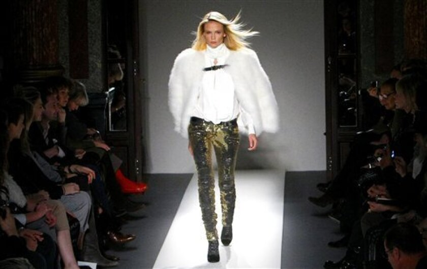 A model presents a creation by French fashion designer Christophe Decarnin for Balmain as part of his Fall-Winter 2010-2011 Ready to Wear fashion collection, presented in Paris, Thursday, March. 4, 2010. (AP Photo/Jacques Brinon)