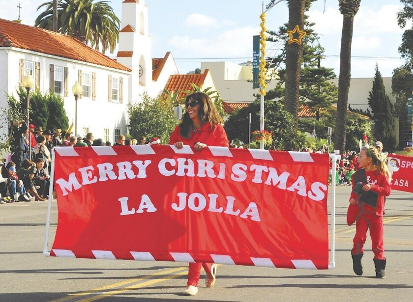 "A scene from the 2013 La Jolla Christmas Parade. Residents and community members continue to debate having the word ""Christmas"" in the name of the annual event, which attracts thousands of spectators to the Village of La Jolla."
