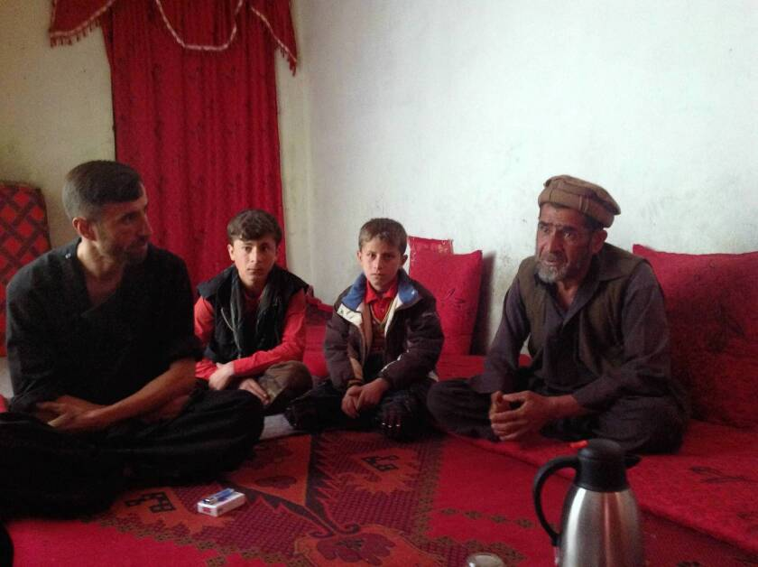An Afghan farmer tills under his dreams for his son