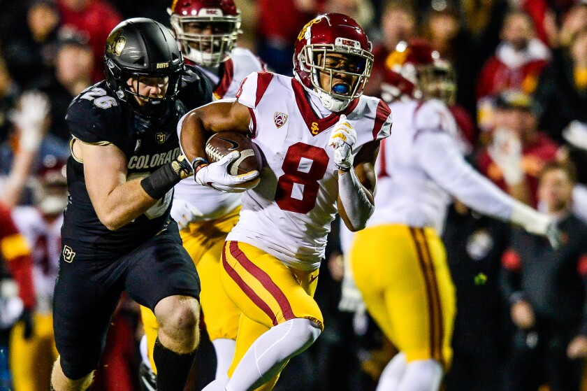 Amon-ra St. Brown carries the ball for USC against Colorado in the first quarter of Friday's game.