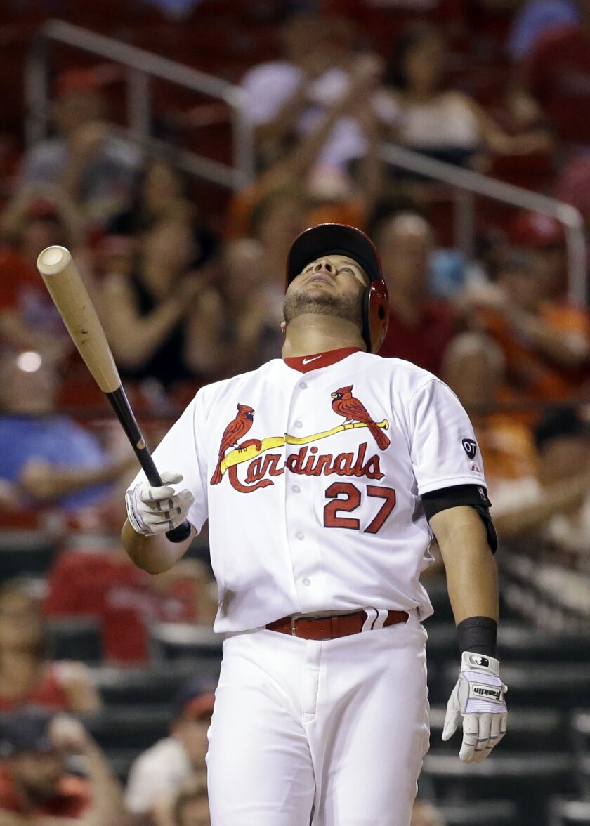 St. Louis Cardinals' Jhonny Peralta reacts to being called out on strikes during the ninth inning of a baseball game against the San Francisco Giants, Tuesday, Aug. 18, 2015, in St. Louis. The Giants won 2-0. (AP Photo/Jeff Roberson)