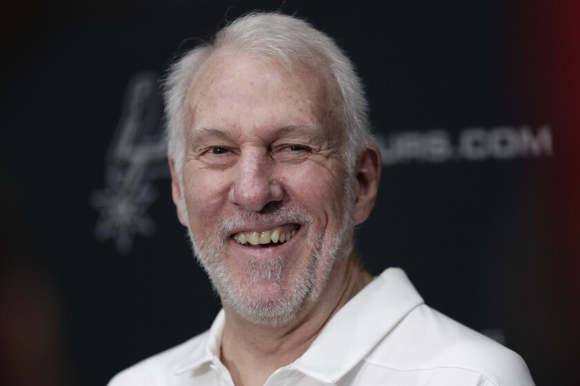 FILE - In this Sept. 30, 2019, file photo, San Antonio Spurs head coach Gregg Popovich talks with the media during NBA basketball media day in San Antonio. Freshmen at the United States Air Force Academy are called doolies, and the experience for those first-year cadets can be extremely difficult. Popovich, class of 1970, hasn't forgotten those days. And for the San Antonio coach, a couple days of lockdown at Walt Disney World brought back the memories of doolie life. (AP Photo/Eric Gay, File)
