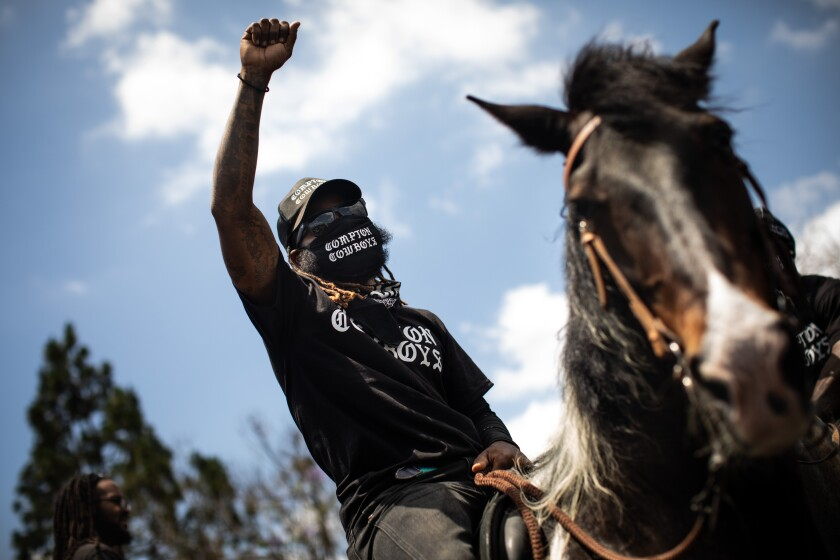 Keenan Abercrombia, a member of the Compton Cowboys, before departing on a June 7 Peace Ride through Compton.