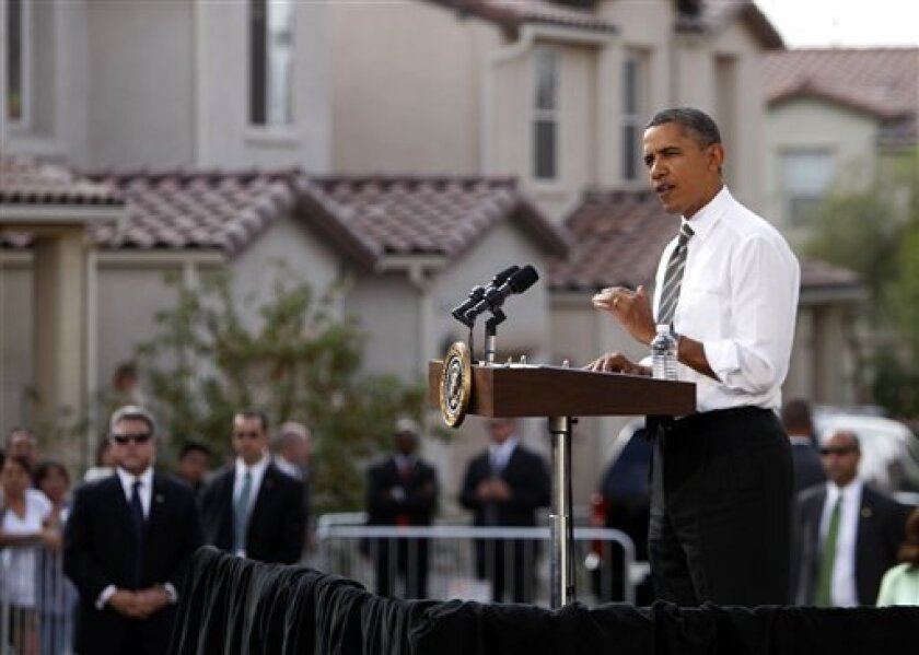 President Barack Obama speaks in Las Vegas, Monday, Oct. 24, 2011. Obama, in Las Vegas during a three-day trip to the West Coast, announced new rules to help homeowners with little or no equity in their home to refinance their mortgages to avoid foreclosures. (AP Photo/John Locher)