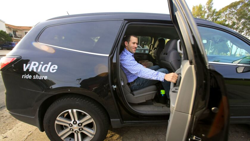 Illumina employee Joshua Bender, a validation engineer, closes the door to the vanpool he and other employees will ride in from North Park to the company facilities in University City.