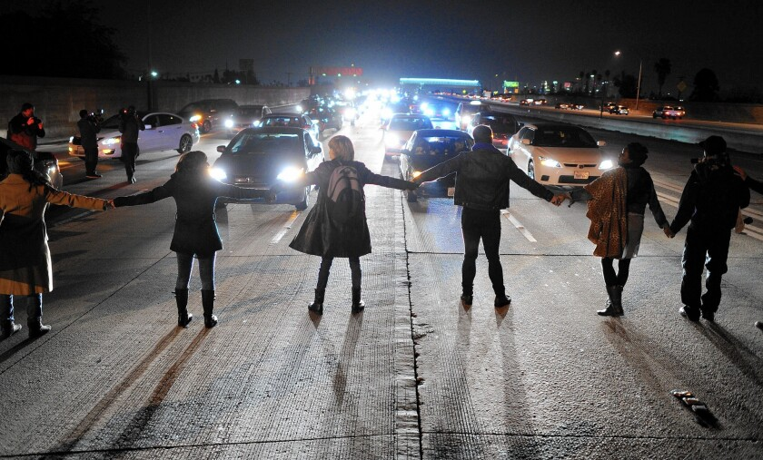 Protesters block freeway