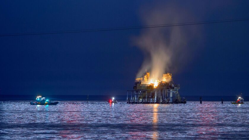 Authorities respond to an oil rig explosion on Lake Pontchartrain off Kenner, La., on Sunday.