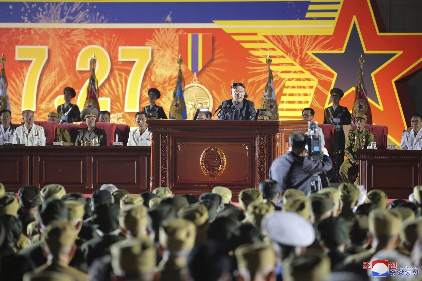 """In this photo provided by the North Korean government, North Korean leader Kim Jong Un, center, delivers a speech during the 7th National Conference of War Veterans in Pyongyang, North Korea, Tuesday, July 27, 2021, on the occasion of the Korean War armistice anniversary. Independent journalists were not given access to cover the event depicted in this image distributed by the North Korean government. The content of this image is as provided and cannot be independently verified. Korean language watermark on image as provided by source reads: """"KCNA"""" which is the abbreviation for Korean Central News Agency. (Korean Central News Agency/Korea News Service via AP)"""
