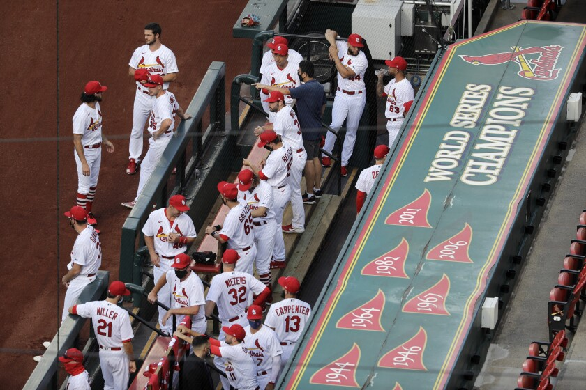 Members of the St. Louis Cardinals wait to be introduced before the start of a game against the Pittsburgh Pirates.