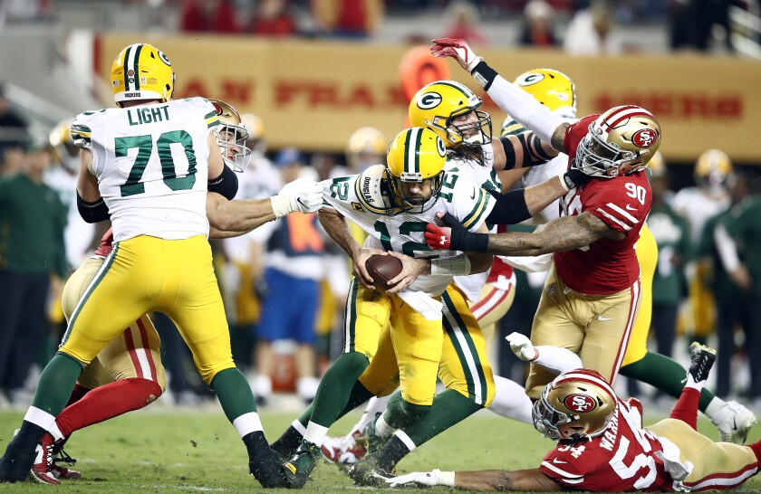 Green Bay quarterback Aaron Rodgers is pressured by San Francisco's defense during the 49ers' 37-8 victory Nov. 24, 2019.