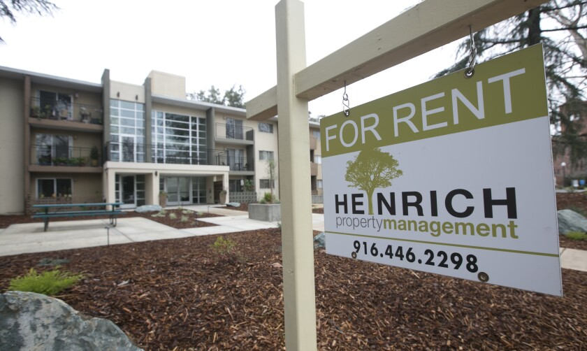 """This 2017 photo shows a """"For Rent"""" sign outside an apartment building in Sacramento."""
