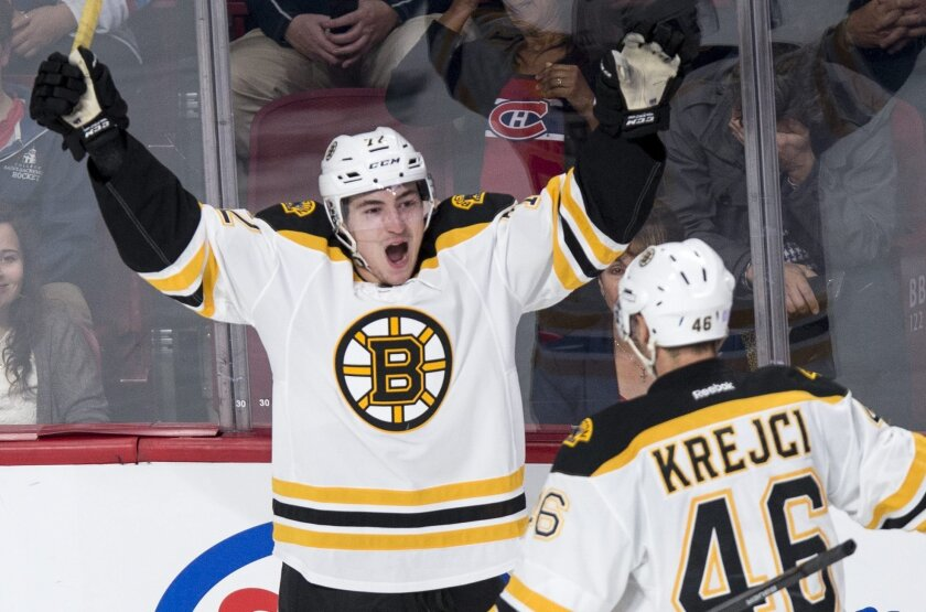Boston Bruins' Frank Vatrano (72) celebrates his goal against the Montreal Canadiens with teammate David Krejci (46) during second period NHL hockey action, in Montreal, on Saturday, Nov. 7, 2015. (Paul Chiasson/The Canadian Press via AP)