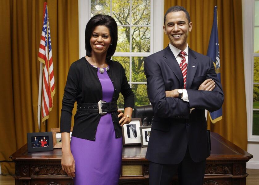 A waxwork of U.S. First Lady Michelle Obama joins that of her husband U.S. President Barack Obama, m