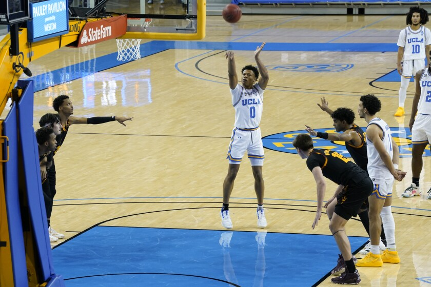 UCLA guard Jaylen Clark makes a free throw to give UCLA the lead with 1.4 seconds remaining.