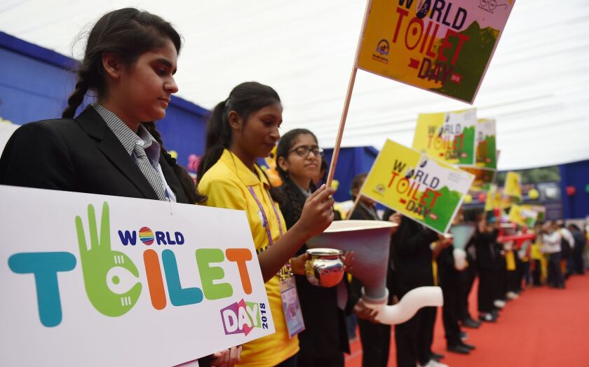 Indian children hold placards during an event to celebrate World Toilet Day in New Delhi on Monday. World Toilet Day is held on November 19 each year and is a campaign to raise awareness of issues surrounding health and sanitation.