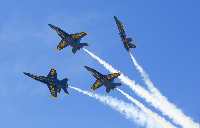 The Navy Blue Angels perform high speed flight maneuvers for the crowd at the Miramar Air Show.