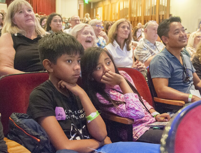 Winston and Betty Ordona, both 11, with Dad Michael Ordona, listen to Chelsea Clinton during the Los Angeles Times Festival of Books on Sunday at USC.