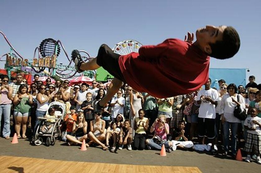 Lanny Markasky of the street dance group Mala Vida participates in a tumbling exercise at the Santa Monica Pier.