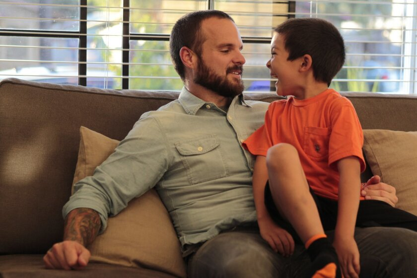 Nate Appleman, a nationally known chef who raises money for Kawasaki disease research, with his son Oliver, who was diagnosed with the disease when he was 2, in their San Diego home.