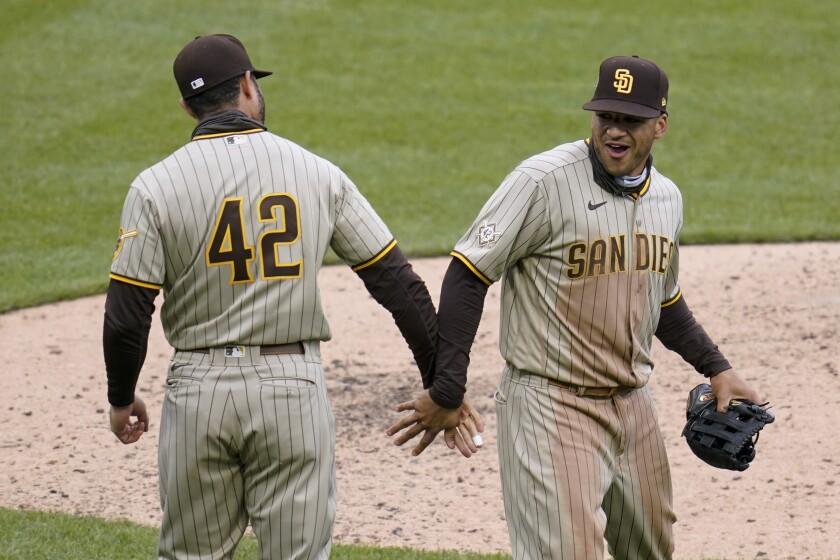 The Padres' Trent Grisham, right, celebrates with Eric Hosmer