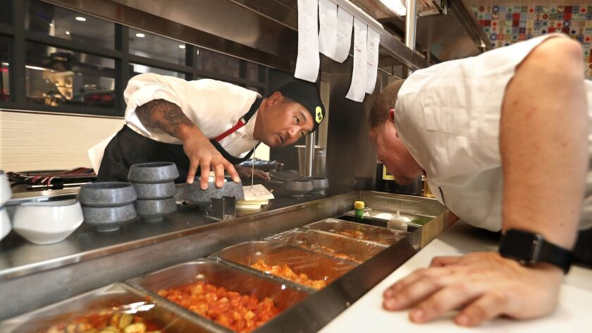 Chef Roy Choi left, has a discussion with his executive chef Diego Echavarria, while inside the kitchen of his new restaurant, Best Friend, located inside the Park MGM hotel on the Las Vegas Strip.