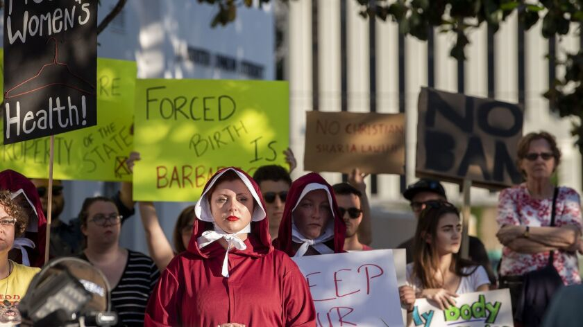 Margeaux Hartline, dressed as a handmaid, during a rally against HB314, the near-total ban on aborti