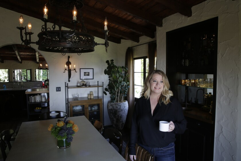 Designer Deirdre Doherty stands in the dining area of the home she updated.