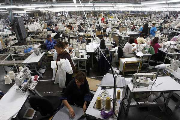 American Apparel workers put together garments in South Gate. All five of the company's manufacturing operations are in Southern California, with its largest factory in downtown Los Angeles.