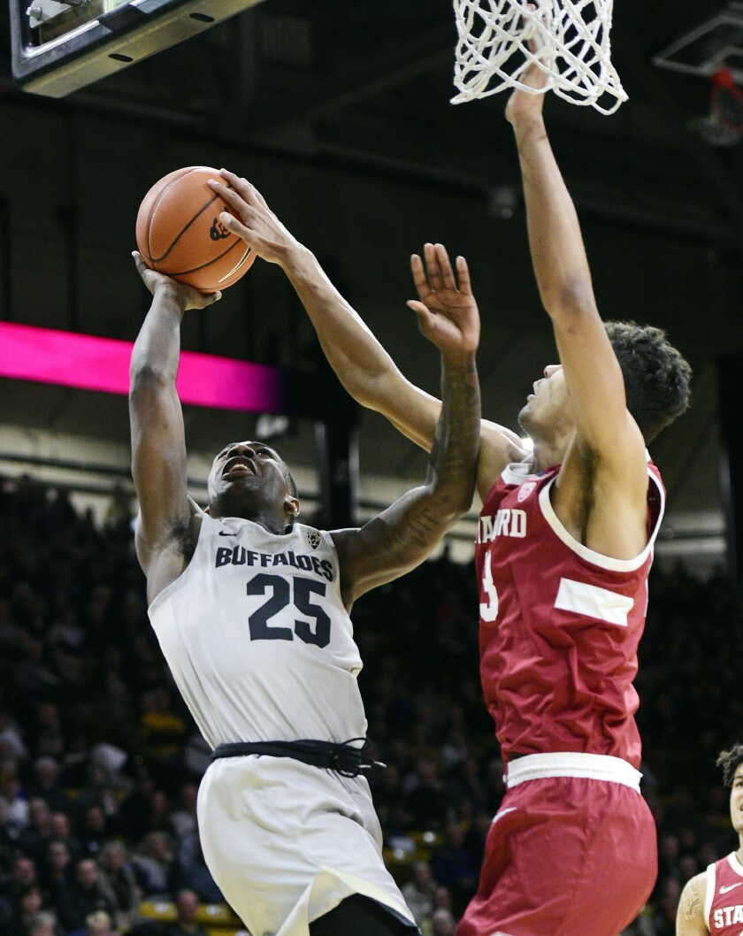 Colorado's McKinley Wright IV has his shot blocked by Stanford's Oscar Da Silva during the first half of an NCAA college basketball game Saturday, Feb. 8, 2020, in Boulder, Colo. (AP Photo/Cliff Grassmick)