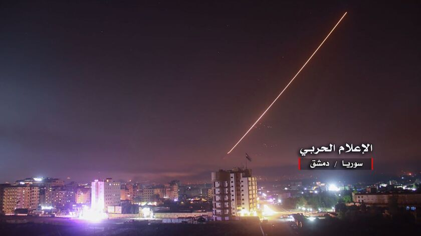 "An image released by the government-affiliated ""Central War Media"" in Syria purportedly shows Syrian antiaircraft systems intercepting an Israeli missile."