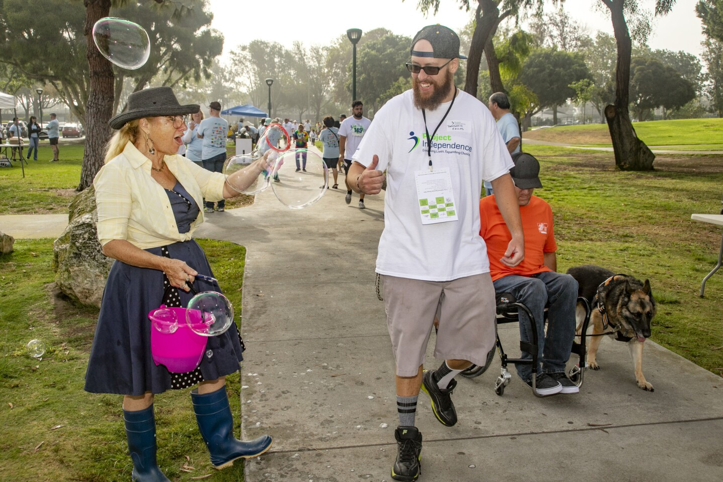 Ben Fallas gets a bubbly reception from Ellyn Hale as he participates in Saturday's Walk for Independence presented by Project Independence, a Costa Mesa-based nonprofit that supports people with developmental disabilities.