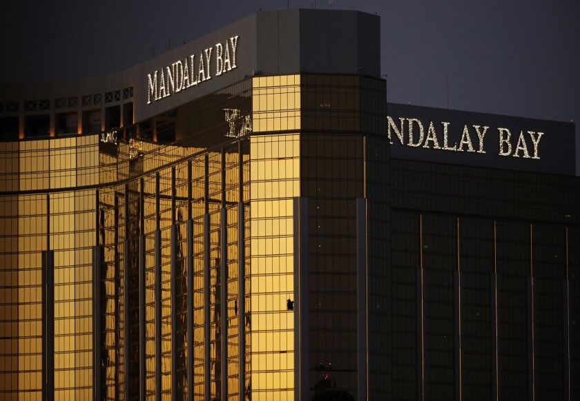 In this Oct. 3, 2017, file photo, windows are broken at the Mandalay Bay resort and casino in Las Vegas, the room from where Stephen Craig Paddock fired on a nearby music festival, killing 58 and injuring hundreds on Oct. 1.