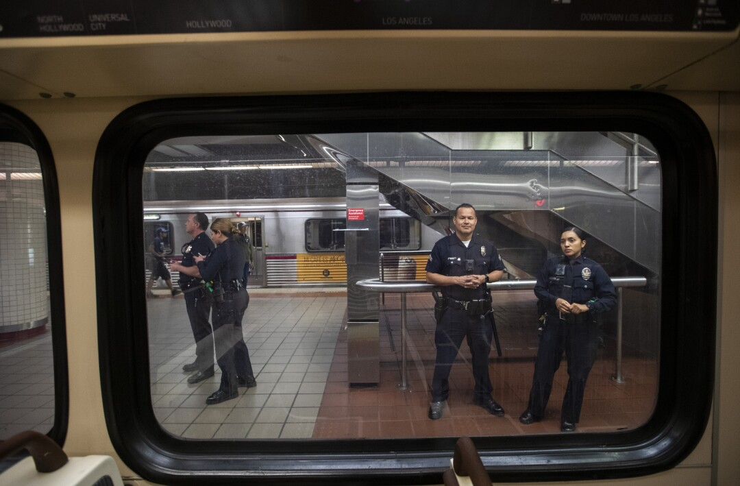 LAPD officers patrol inside the 7th Street/Metro Center subway station in Los Angeles.