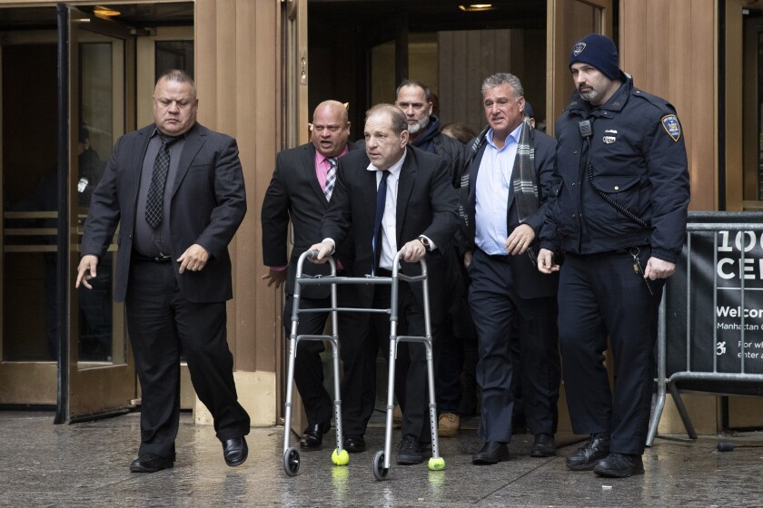 Harvey Weinstein, center, leaves court following a bail hearing Friday in New York.