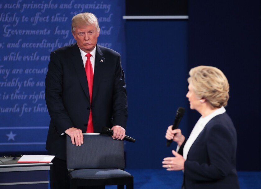 Donald Trump and Hillary Clinton at presidental debate in St. Louis, Mo.