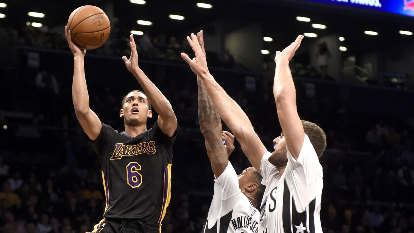 Lakers guard Jordan Clarkson tries to score on a driving layup against Nets forward Rondae Hollis-Jefferson and center Brook Lopez in the first half Friday night.