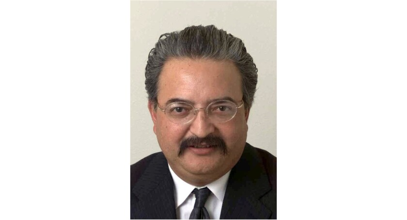Valeriano Saucedo, shown in this 2002 staff photo, has been removed as a judge in Tulare County after he tried to manipulate his way into a relationship with his courtroom clerk.
