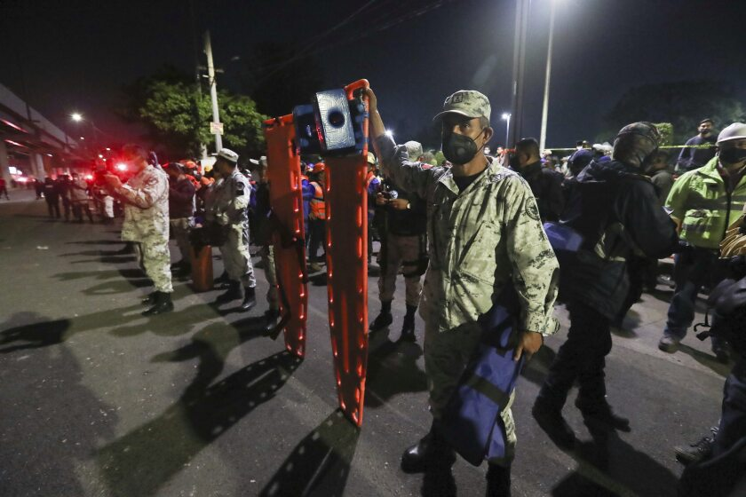 Mexican soldiers hold stretchers