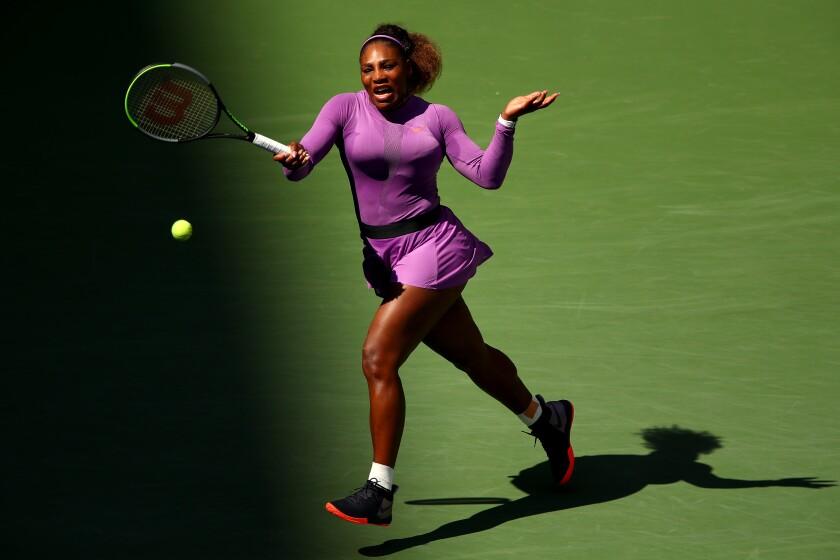 Serena Williams returns a shot during her third-round match against Karolina Muchova at the U.S. Open on Friday.