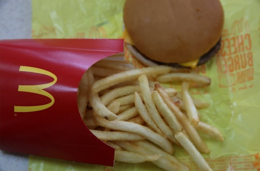An analysis of burgers, fries and other popular menu items at fast-food restaurants finds the amount of salt, fat and calories hasn't changed much since 1996.