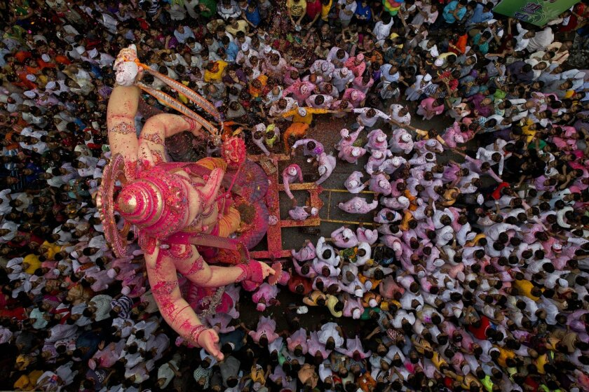Indian Hindu devotees mass around a large statue of the elephant-headed Hindu God Ganesha on the way to immerse it in the Arabian Sea on the final day of the festival of Ganesha Chaturthi in Mumbai, India, Monday, Sept. 8, 2014. (AP Photo/Bernat Armangue)