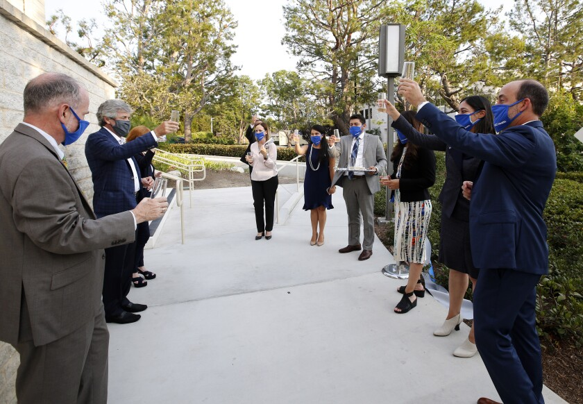 Staff and guests toast during ribbon cutting at the new UCI Health Newport Beach facility, located at Newport Center.