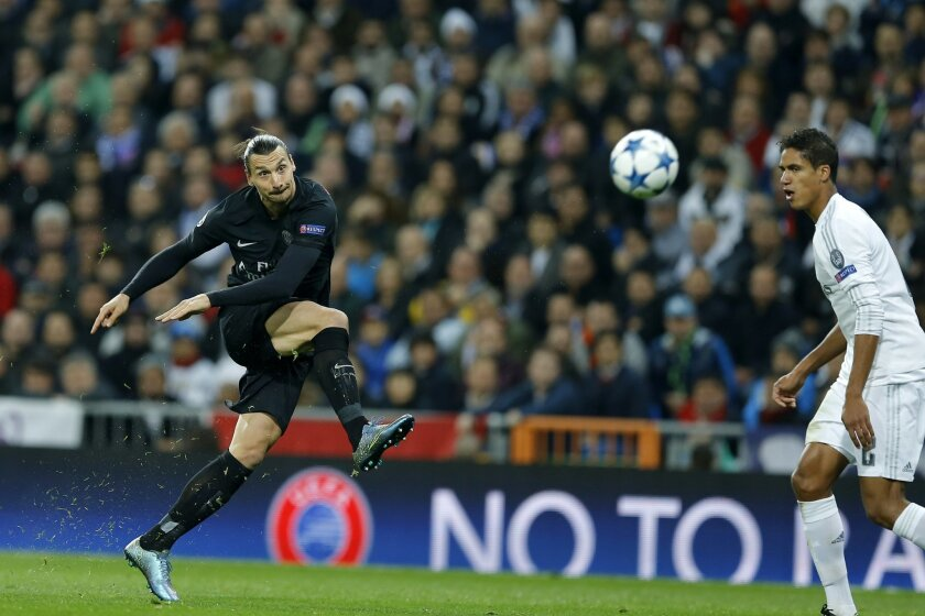 PSG's Zlatan Ibrahimovic makes a shot during the Champions League group A soccer match between Real Madrid and PSG at the Santiago Bernabeu stadium in Madrid, Tuesday, Nov. 3, 2015. (AP Photo/Francisco Seco)