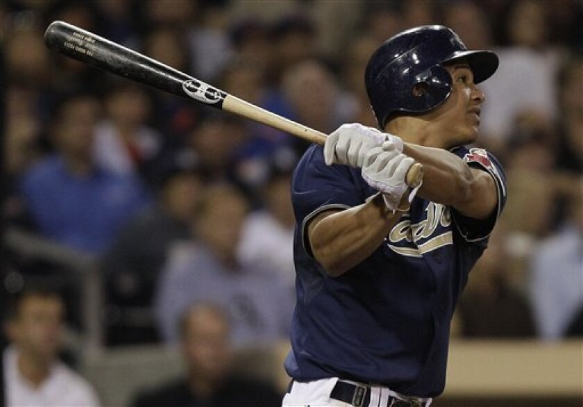 San Diego Padres' Will Venable watches the flight of his grand slam against the Chicago Cubs in the sixth inning of a baseball game on Wednesday, Sept. 28, 2011, in San Diego. (AP Photo/Lenny Ignelzi)