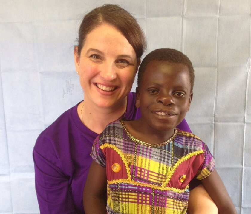 Dr. Amanda Gosman with Grace, one of her patients in Malawi.  / courtesy photo