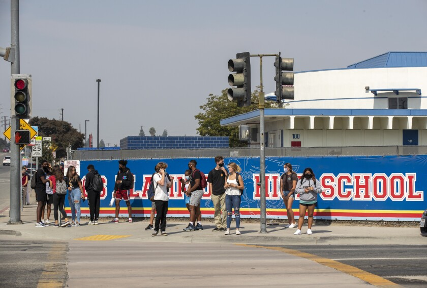 Students leave campus after a day of in-class learning at Los Alamitos High School.