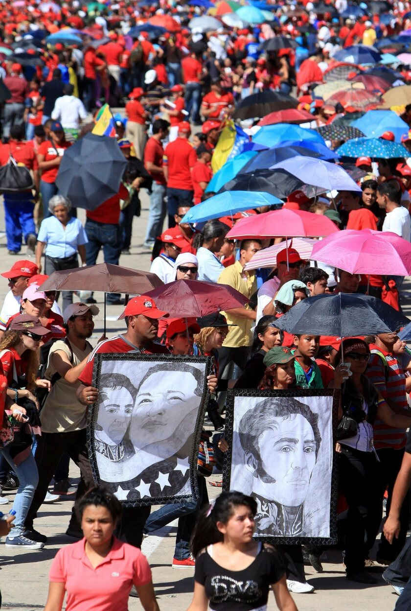 Thousands wait in line to see the body of the late Venezuelan President Hugo Chavez in Caracas.