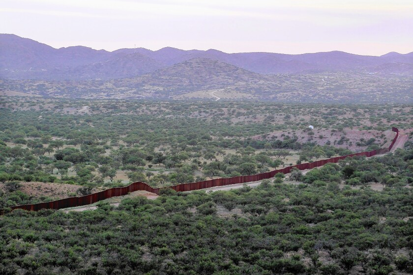 A fence marks the U.S.-Mexico border near Sasabe, Ariz. U.S. officials said Border Patrol agents were fired upon by Mexican law enforcement officers. Mexican authorities disputed that version of events.